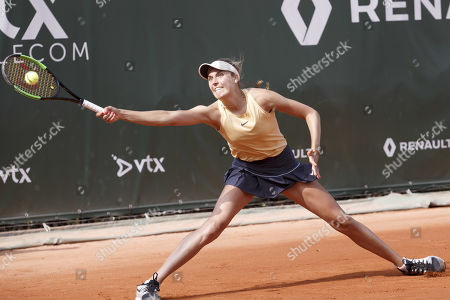 Antonia Lottner, of Germany, returns a ball to Caroline Garcia, of France, during the first round match, at the WTA International Ladies open Lausanne tournament, in Lausanne, Switzerland, Monday, July 15, 2019.