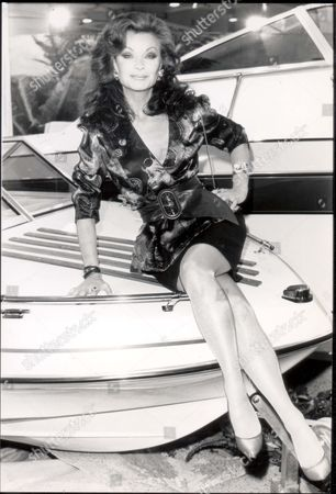 Stock Picture of Kate O'mara - 1989 (this Picture Was Used Coloured In By The Art Department The Daily Mail 29/09/2003 See In 2399527) The Latest Beauty To Sail Down Howards' Way Charted A Change Of Course For The Top Bbc Soap Yesterday. Kate O'mara Is Joining The Series Which Reflects The Lives And Loves Of The Yachting World As It Moves Out Of Its Home Port Of Hamble Hampshire To Drop Anchor In Malta. Two Of The Show's Bitter Rivals Charles Frere And Ken Masters Are Involved In Big Deals On The Island In A Series To Be Filmed Next Month. Kate (above) Will Play A 'ruthless Hard-headed Woman Who Survives In A Male-dominated Business ' Before Returning To Hollywood - 'maybe For A Major Movie.' Yesterday She Was Her Normal Glamorous Self Meeting Malta's Leaders At The 35th International Boat Show In Earl's Court West London. Malta's Government Has Sponsored The Show's Showpiece Feature - A Recreation Of Valletta Harbour And Today Prime Minister Dr Edward Fenech-adami Will Open The Show Organised For The First Time By The British Marine Industry Federation. Among The 600 Boats On Display Is Another Howards' Way Star - The Cruiser Orkadian Of Tarrant Which Is Owned By Glyn Owen Who Plays Jack Rolfe. 1.89...actress