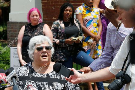 Stock Image of Susan Bro, mother of Heather Heyer, who was killed during the Unite the Right rally in 2017, speaks to reporters after the sentencing of James Alex Fields Jr., at General District Court in Charlottesville, Va., . Fields was sentenced to life plus 419 years for his role in the 2017 Night The Right rally
