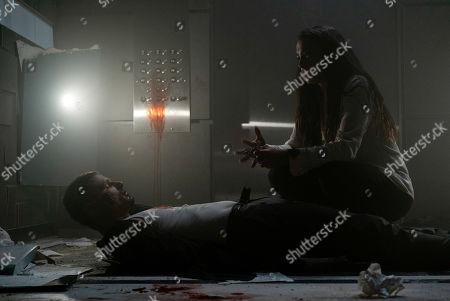 Matt Lauria as Guy/John Deakins and Natalie Martinez as Jennifer Robbins
