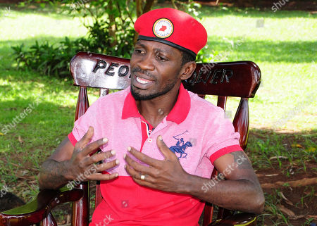 Pop star-turned-opposition lawmaker Bobi Wine, whose real name is Kyagulanyi Ssentamu, is seen while giving an interview to Associated Press at his home,Magere in Kampala, Uganda . Bobi Wine, Uganda's pop star-turned-opposition leader, says he will challenge longtime President Yoweri Museveni in polls set for 2021, but Wine, says he is concerned about his safety