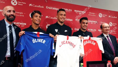 Spanish midfielder Oliver Torres (2-L), Argentinian winger Lucas Ocampos (3-L), Spanish defender Sergio Reguilon (2-R), pose for the media accompanied by Sevilla's sports director Ramon Rodriguez 'Monchi' (L), and Spanish president Jose Castro (R) during their presentation as new players of Sevilla FC in Seville, Spain, 15 July 2019. E