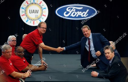 Gary Jones, Bill Ford. United Auto Workers President Gary Jones, left, and Ford Motor Co., Executive Chairman Bill Ford shake hands to open their contract talks, in Dearborn, Mich