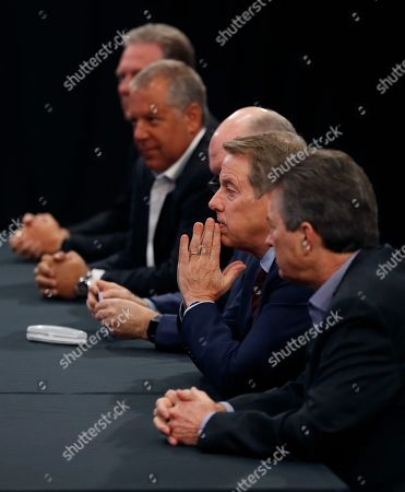 Stock Picture of Ford Motor Co., Executive Chairman Bill Ford, second from right, listens as contract talks with the United Auto Workers begin, in Dearborn, Mich