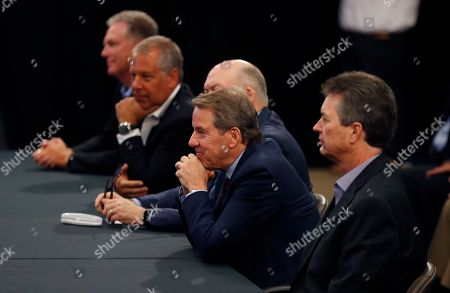 Ford Motor Co., Executive Chairman Bill Ford, second from right, listens as contract talks with the United Auto Workers begin, in Dearborn, Mich
