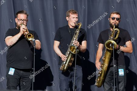 Brass instrument players of the Tom Grennan band