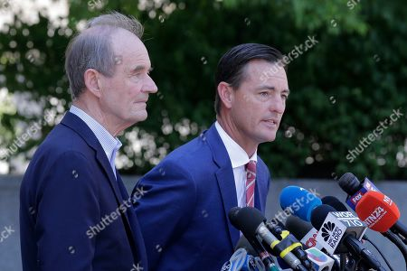 Attorneys David Boies, left and Brad Edwards speak to reporters outside the courthouse in New York, .Financier Jeffrey Epstein will remain behind bars for now as a federal judge mulls whether to grant bail on charges he sexually abused underage girls