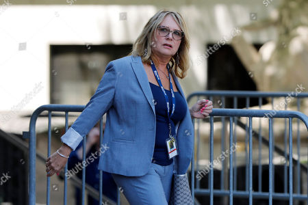 Miami Herald reporter Julie Brown leaves federal court after Jeffrey Epstein's appearance, in New York, . The judge says he'll announce his decision on Epstein's bail Thursday