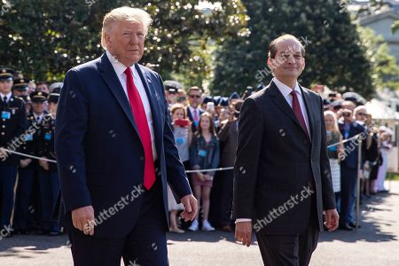 Labor Secretary Alexander Acosta walks with U.S. President Donald Trump shortly before announcing his resignation on the White House South Lawn as Trump prepares to depart the White House aboard Marine One