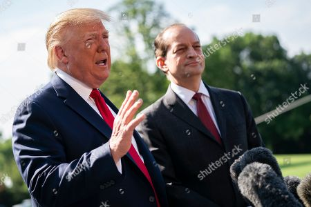 U.S. President Donald Trump speaks with reporters with Labor Secretary Alexander Acosta as Trump prepares to depart the White House aboard Marine One. Acosta handed his resignation to Trump this morning.