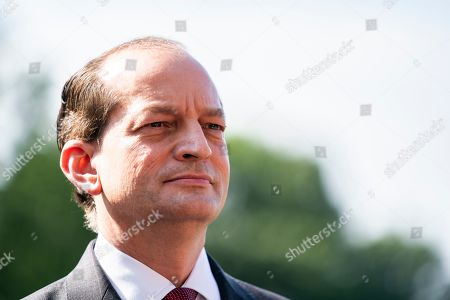 Labor Secretary Alexander Acosta announces his resignation as he stands next to President Trump as Trump prepares to depart the White House aboard Marine One.