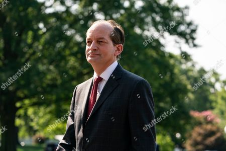 Labor Secretary Alexander Acosta enters the White House after announcing his resignation as he stood next to President Trump as Trump prepares to depart the White House aboard Marine One. Acosta handed his resignation to Trump this morning.