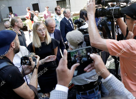 Alleged sex victim Annie Farmer (C) and her lawyer David Boies (C-R) walks away after a detention hearing for accused sex trafficker Jeffrey Epstein at US Federal Court  in New York, New York, USA, 15 July 2019.
