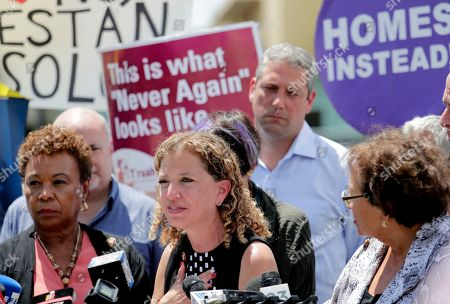 Rep. Debbie Wasserman Schultz, D-Fla, center, speaks during a news conference following a tour of the Homestead Temporary Shelter for Unaccompanied Children, in Homestead, Fla. At left is Rep. Barbara Lee, D-Ca
