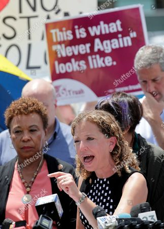 Rep. Debbie Wasserman Schultz, D-Fla., right, speaks during a news conference following a tour of the Homestead Temporary Shelter for Unaccompanied Children, in Homestead, Fla. At left is Rep. Barbara Lee, D-Ca