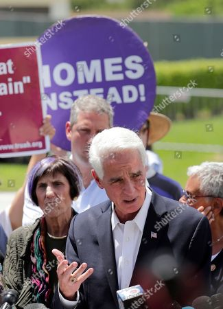 Rep. Charlie Crist, D-Fla., right, speaks during a news conference following a tour of the Homestead Temporary Shelter for Unaccompanied Children, in Homestead, Fla