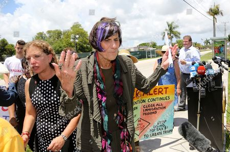 Rep. Rosa DeLauro, D-Conn., right, and Rep. Debbie Wasserman Schultz, D-Fla., left, walk away from the podium following a tour of the Homestead Temporary Shelter for Unaccompanied Children, in Homestead, Fla