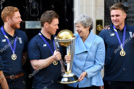 Theresa May with Jonny Bairstow, Eoin Morgan and Jason Roy of the winning England Cricket Team with the ODI World Cup
