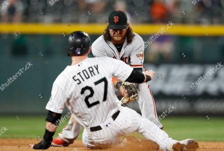 Brandon crawford, r m. San Francisco Giants shortstop Brandon crawford, back, applies the tag to force out Colorado Rockies' Trevor Story at second base on a ground ball hit by David Dahl in the ninth inning of a baseball game, in Denver. The Giants won 2-1