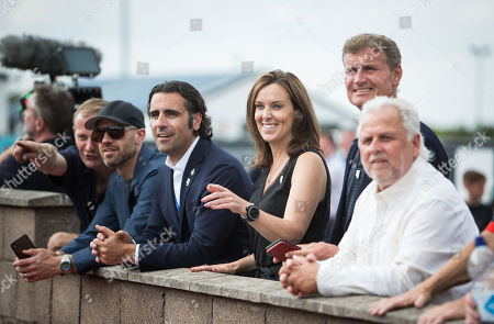 Former Indianapolis 500 Champion Dario Franchitti, Tv Presenter Lee McKenzie and former F1 driver David Coultard watch the action on the track