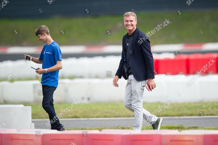 Former F1 driver David Coulthard watching the racing on the track