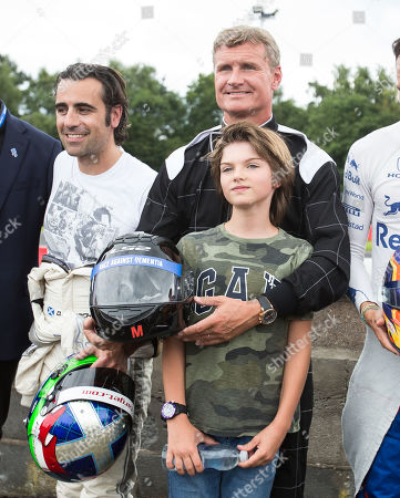Former F1 driver David Coulthard with his son Dayton after racing on the track