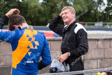 Stock Image of Former F1 driver David Coulthard with McLaren F1 driver Lando Norris after racing on the track