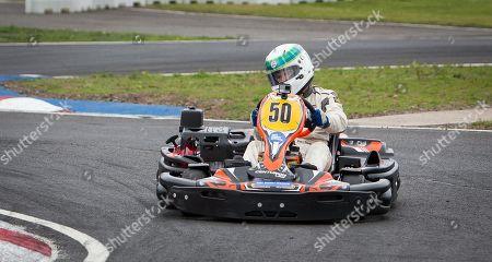 Paul Stewart son of Sir Jackie Stewart racing his Kart on the track