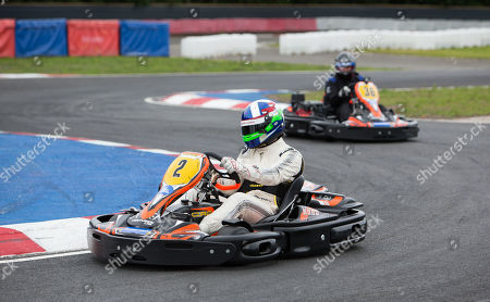 Stock Image of Former Indianapolis 500 Champion Dario Franchitti racing his Kart on the track