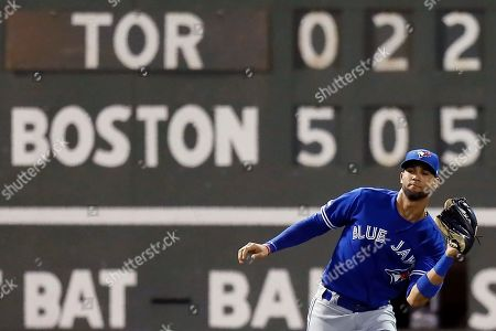 Toronto Blue Jays' Lourdes Gurriel Jr. makes the catch on a flyout by Boston Red Sox's Sandy Leon during the fourth inning of a baseball game in Boston