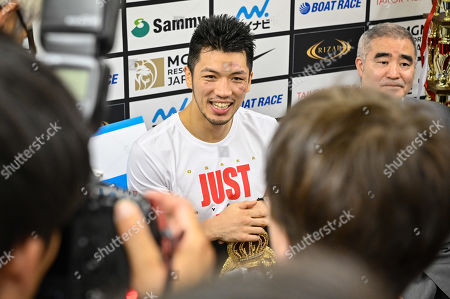 Ryota Murata of Japan speakes to media after winning
