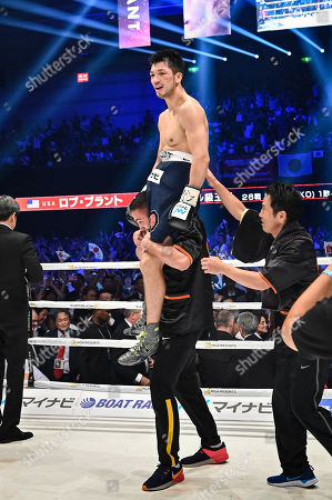 Ryota Murata of Japan celebrates after winning