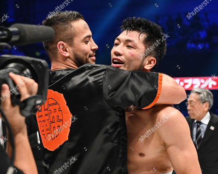 Ryota Murata of Japan celebrates with trainer Carlos Linares after winning