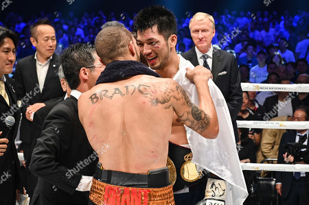 Ryota Murata of Japan embraces with Rob Brant of United States after the WBA middleweight title bout