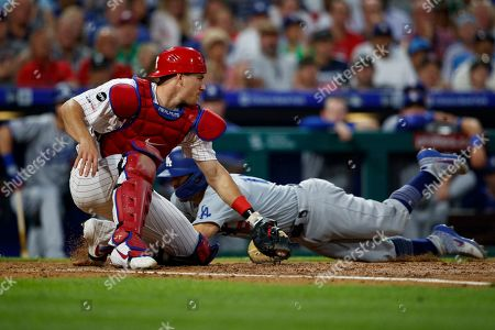 J.T. Realmuto, Austin Barnes. Los Angeles Dodgers' Austin Barnes, right, steals home past Philadelphia Phillies catcher J.T. Realmuto, left, during the fourth inning of a baseball game, in Philadelphia