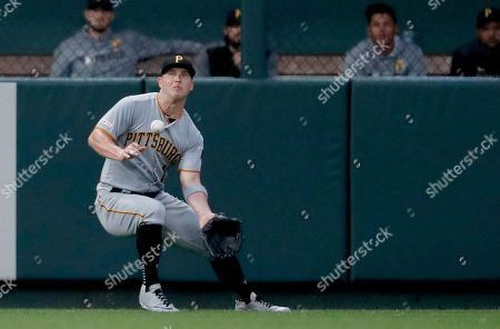 Pittsburgh Pirates left fielder Corey Dickerson is unable to catch a fly ball by St. Louis Cardinals' Tyler O'Neill during the first inning of a baseball game, in St. Louis. The Cardinals' Paul Goldschmidt scored and Dickerson was charged with an error on the play