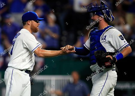 Ian Kennedy, Cam Gallagher. Kansas City Royals relief pitcher Ian Kennedy, left, shakes hands with catcher Cam Gallagher, right, following a baseball game against the Chicago White Sox at Kauffman Stadium in Kansas City, Mo
