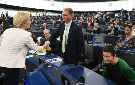 German Defense Minister Ursula von der Leyen and nominated President of the European Commission handshakes Spokesperson of the European Green Party Philippe Lamberts before her statement at the European Parliament in Strasbourg, France, 16 July 2019.