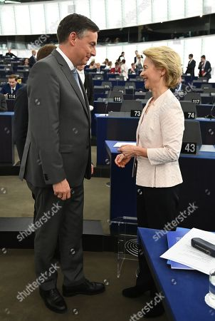 David McAllister (L), Member of Parliament from the EPP Group speaks with German Defense Minister Ursula von der Leyen (R) and nominated President of the European Commission before her statement at the European Parliament in Strasbourg, France, 16 July 2019.