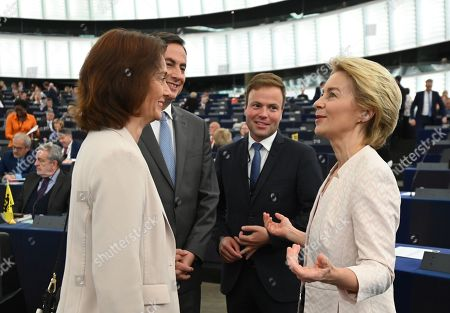 Stock Picture of Katarina Barley from the Group of the Progressive Alliance of Socialists and Democrats in the European Parliament , David McAllister, Member of Parliament from the EPP Group speaks with German Defense Minister Ursula von der Leyen (L-R) and nominated President of the European Commission before her statement at the European Parliament in Strasbourg, France, 16 July 2019.