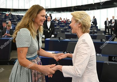 Austrain Green MP and television cook Sarah Wiener (L) hugs German Defense Minister Ursula von der Leyen (R) and nominated President of the European Commission before her statement at the European Parliament in Strasbourg, France, 16 July 2019.