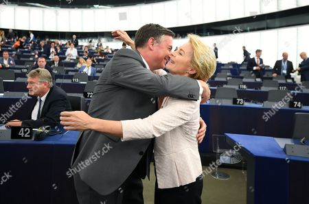 Stock Photo of Member of Parliament from the EPP Group David McAllister (L) congratulates German Defense Minister and newly elected President of the European Commission, Ursula von der Leyen (R), after a vote at the European Parliament in Strasbourg, France, 16 July 2019. European Parliament voted in favor of Ursula von der Leyen as the new President of the European Commission.