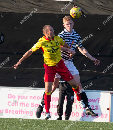 Queens Park V Partick Thistle, Befred Cup. Queens Park Nicky Jamieson out jumps Particks Kenny Miller