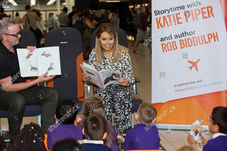 Katie Piper and Rob Biddulph launch Easyjet's Flybrary by reading to children from Luton's Cockernhoe and Ramridge Primary School's at Luton Airport.