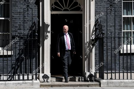 Chris Grayling, Secretary of State for Transport, leaves No.10 Downing Street after attending a cabinet meeting.