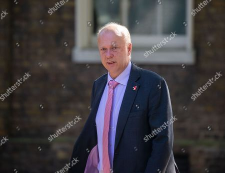 Chris Grayling, Secretary of State for Transport, arrives for the Cabinet meeting.
