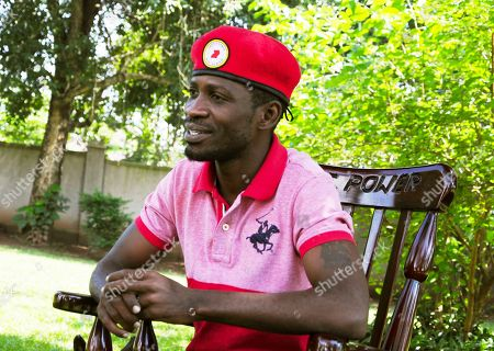 Pop star-turned-opposition lawmaker Bobi Wine, whose real name is Kyagulanyi Ssentamu, is photographed, during an interview with The Associated Press at his home, in Magere, Kampala, Uganda, Monday, July 15, 2019. Wine says he will challenge longtime President Yoweri Museveni in polls set for 2021