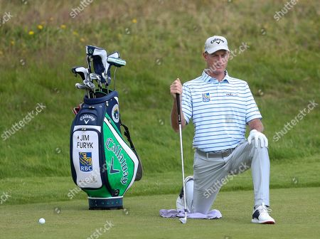 Jim Furyk of the United States stretches on the 1st fairway during a practice round for the British Open Golf championships at Royal Port Rush golf course in Northern Ireland,. The British Open starts Thursday