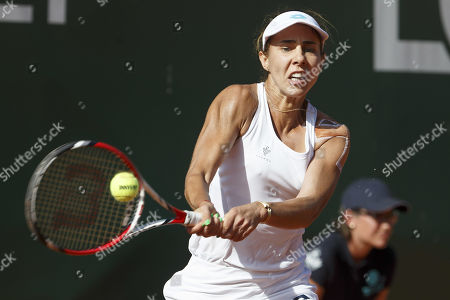 Mihaela Buzarnescu, of Roumania, returns a ball to Stefanie Voegele, of Switzerland, during the first round match, at the WTA International Ladies Open Lausanne tournament, in Lausanne, Switzerland, Tuesday, July 16, 2019.