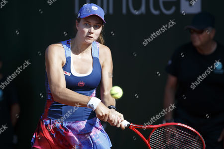 Stefanie Voegele, of Switzerland, returns a ball to Mihaela Buzarnescu, of Roumania, during the first round match, at the WTA International Ladies Open Lausanne tournament, in Lausanne, Switzerland, Tuesday, July 16, 2019.
